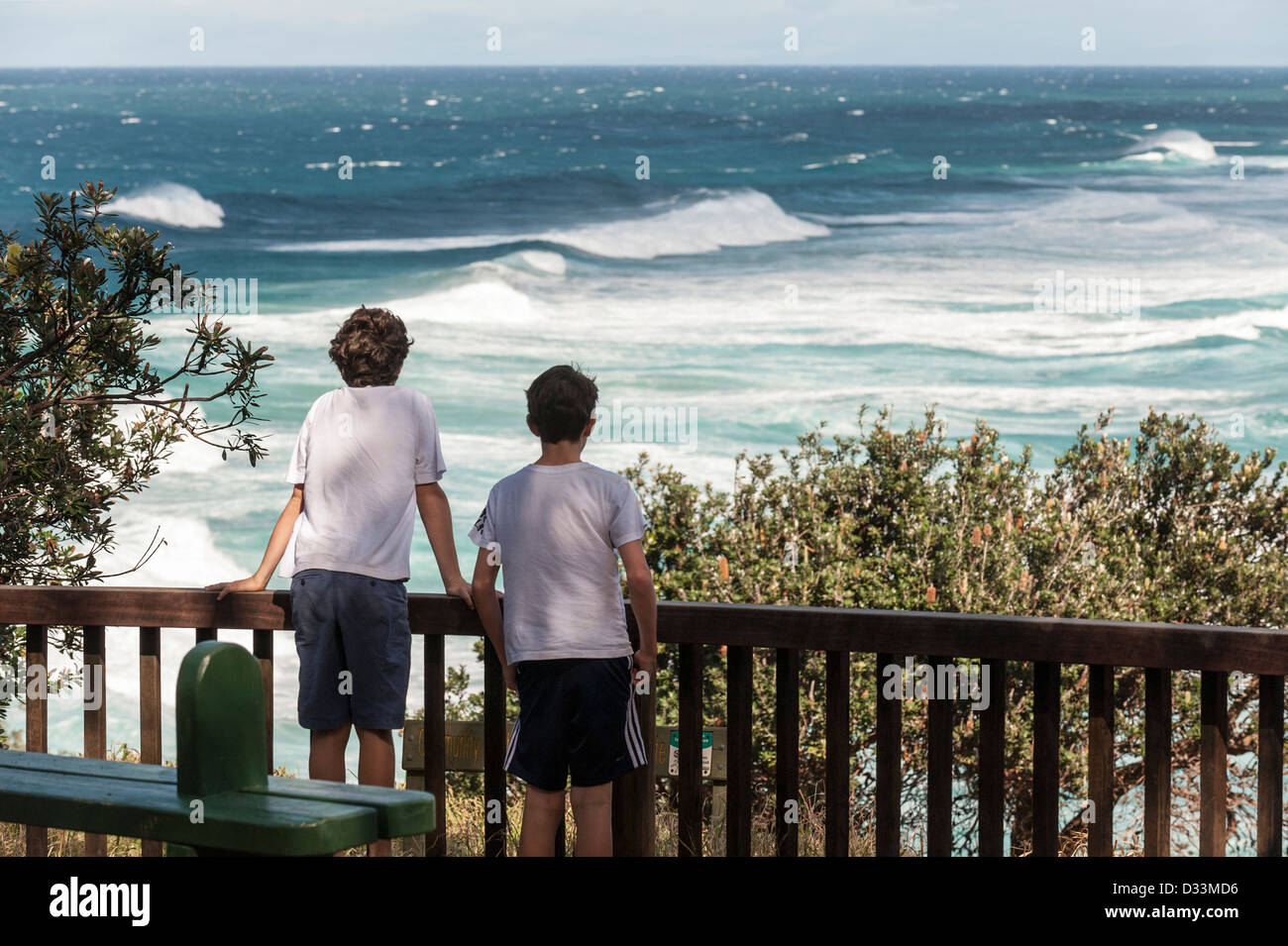North Stradbroke Island, Queensland, Australia - Two young boys looking out over the sea from a viewpoint - Stock Image