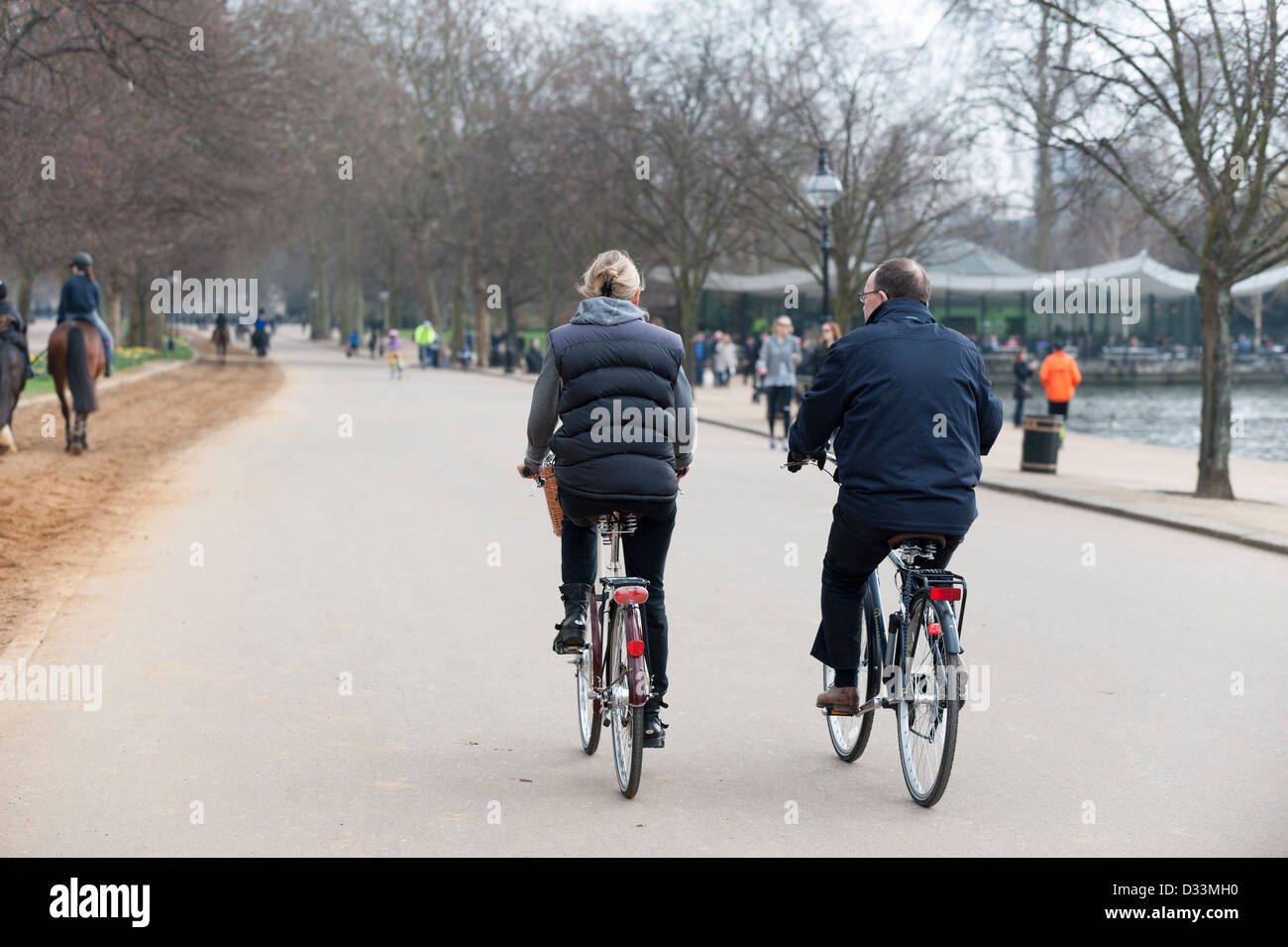 Cycling in Hyde Park, London - cyclists, UK - Stock Image