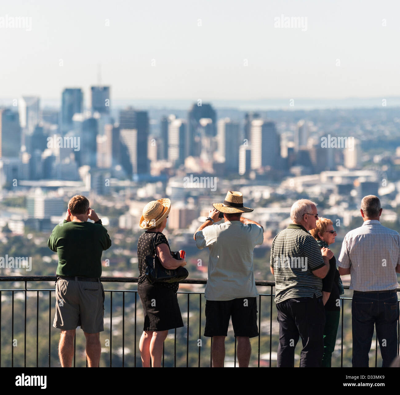 Brisbane, Australia - Tourists looking out over the city from the summit of Mount Coot-Tha - Stock Image