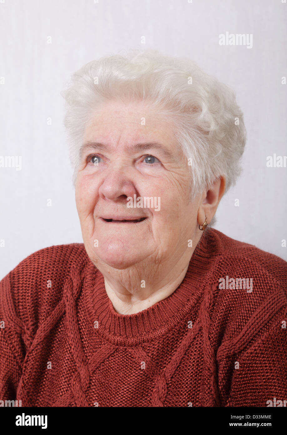 Portrait of serious senior woman in her room - Stock Image