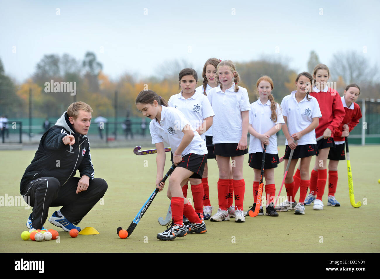 A Games Teacher Instructs Girls During Hockey Practice At Pates