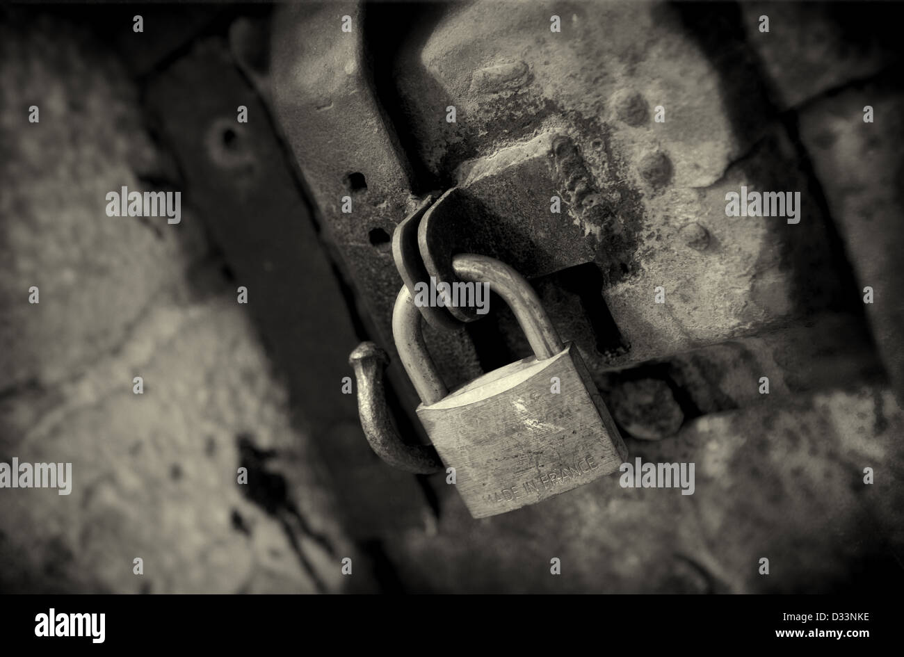 A brass padlock on an old wooden door in Perpignan, France. Stock Photo