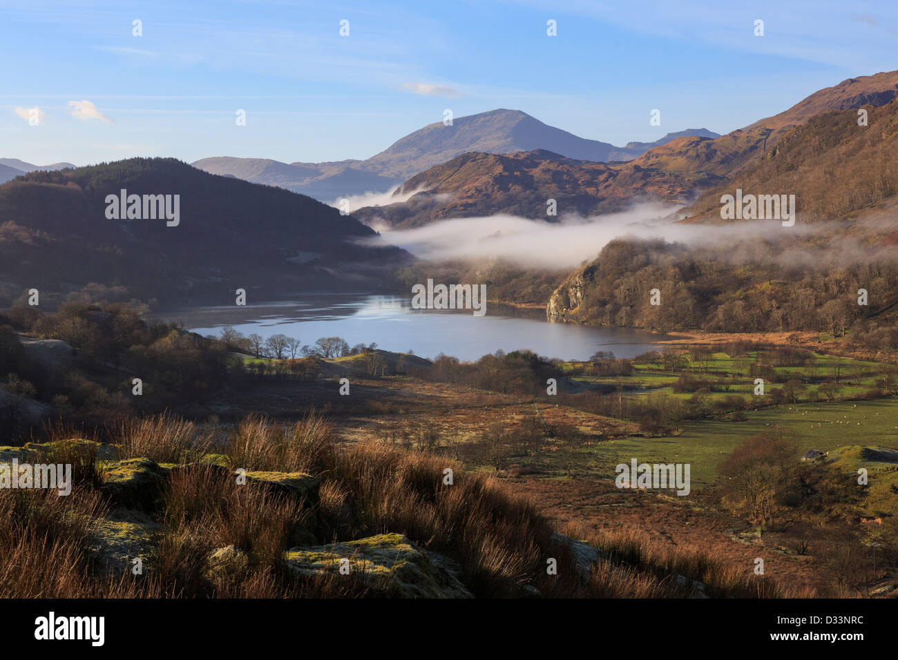 Scenic view along a valley to Llyn Gwynant lake with mist in mountains of Snowdonia National Park, Nantgwynant, North Wales, UK Stock Photo