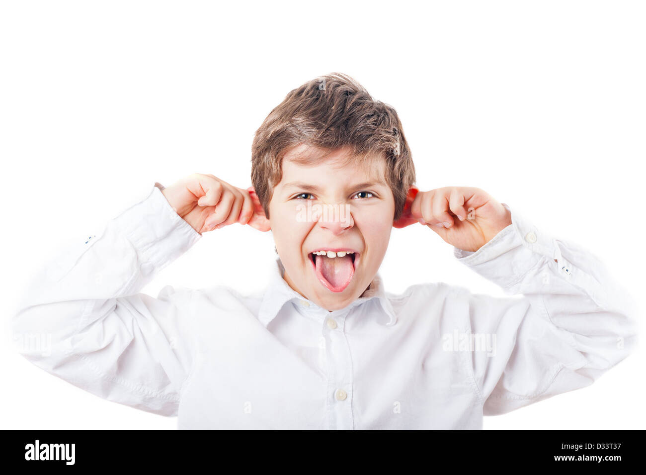 grimacing European boy from the front in the white shirt on a white background - Stock Image