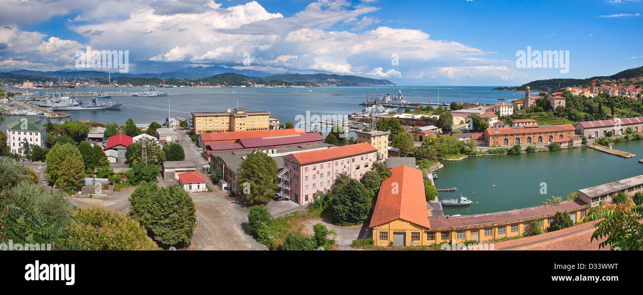 Panorama of navy base on gulf of La Spezia under beautiful blue sky with white clouds on Mediterranean sea in Italy. - Stock Image