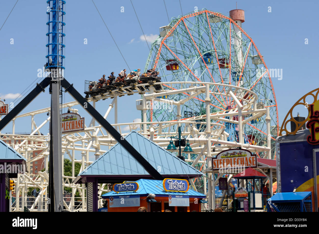 People enjoy the exuberance of the thrill of the fun fair rides at Coney Island, New York City. Stock Photo
