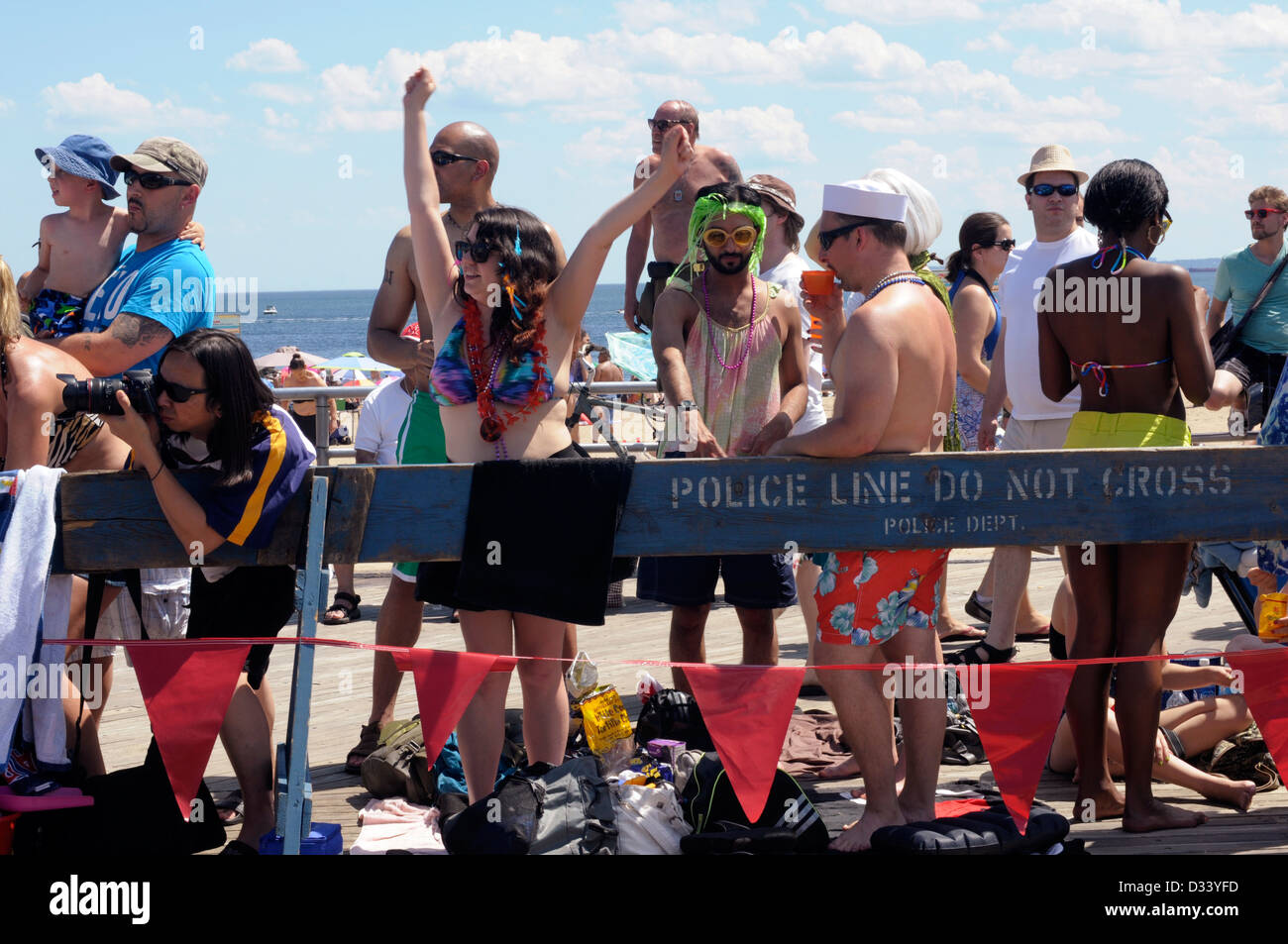 Revellers enjoy the sights and the sunshine at the annual Coney Island Mermaid Parade, 2012. Stock Photo