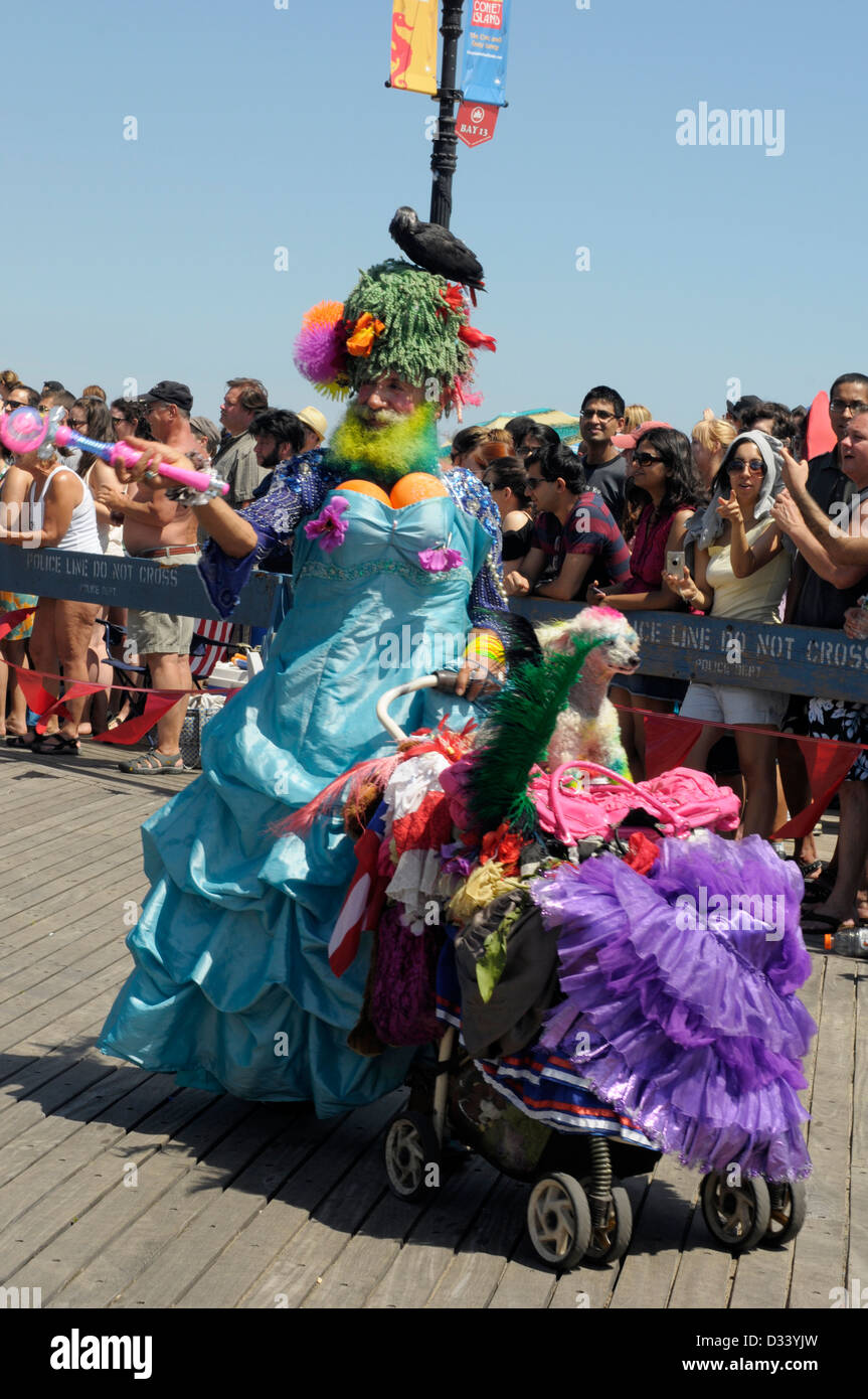 Revellers enjoy the sights and the sunshine at the annual Coney Island Mermaid Parade, 2012. Man dressed as a woman Stock Photo
