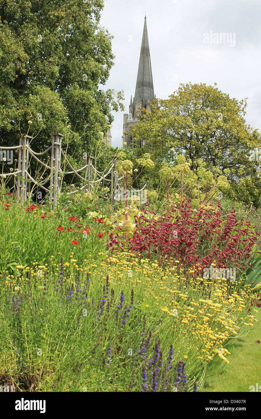 Colourful summer garden border and cathedral spire from the Bishop's Palace Garden, Chichester, West Sussex, - Stock Image