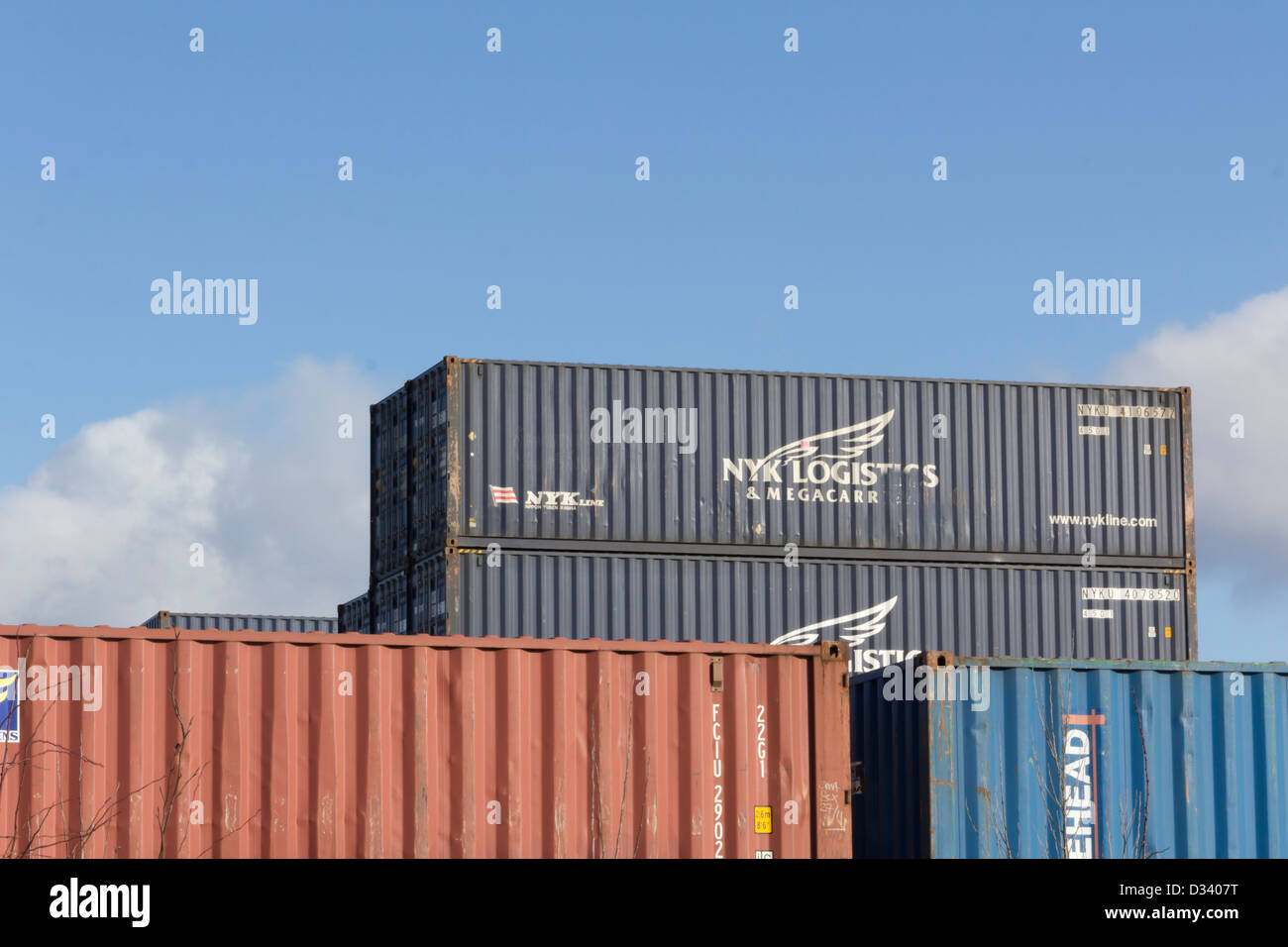 NYK Logistics intermodal shipping containers at the Barton Dock Road container terminal on Trafford Park, Manchester. - Stock Image