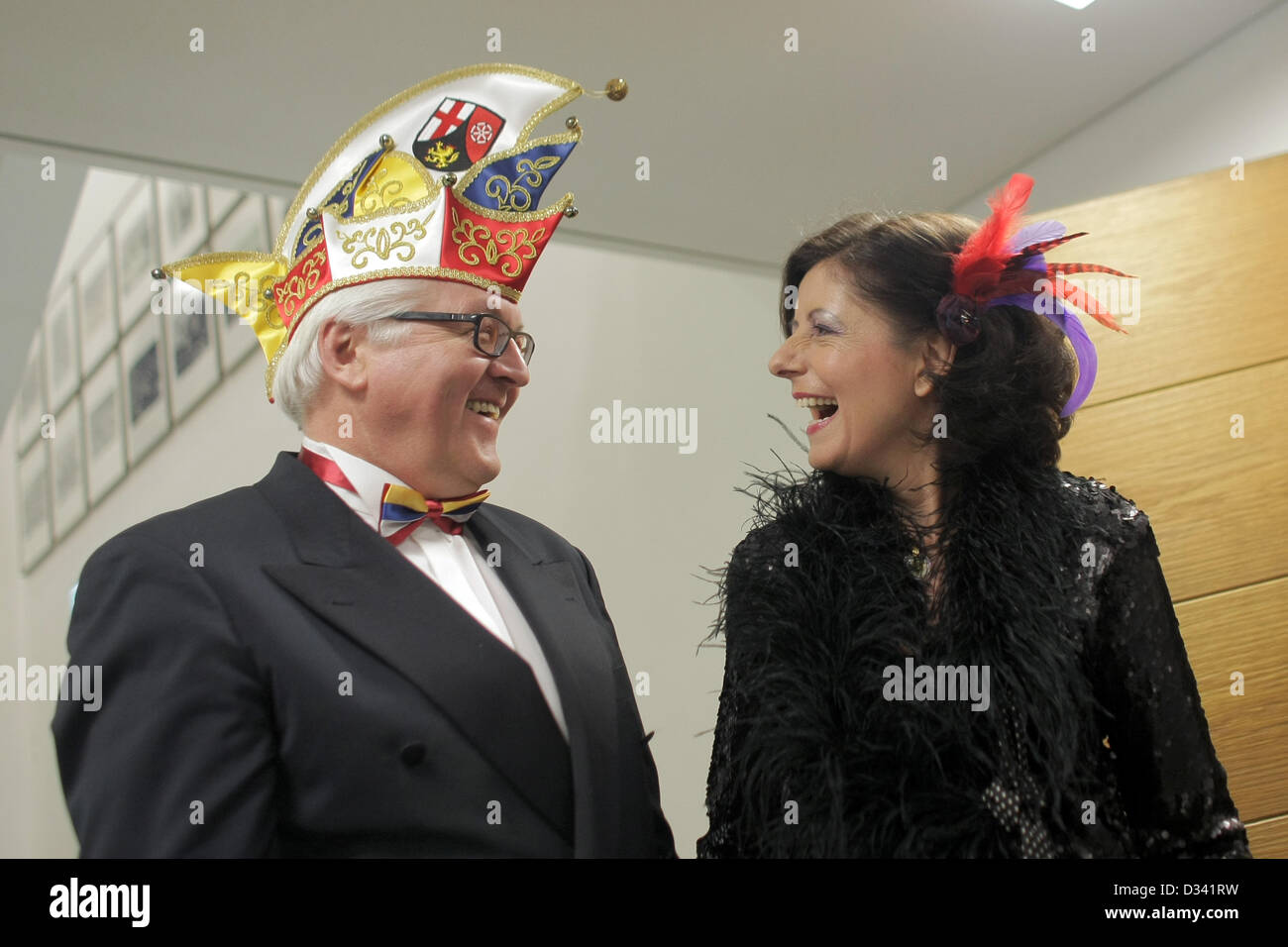 Chairman of the SPD parliamentary group at the Bundestag, FRank-Walter Steinmeier wears a fool's cap and sharea - Stock Image