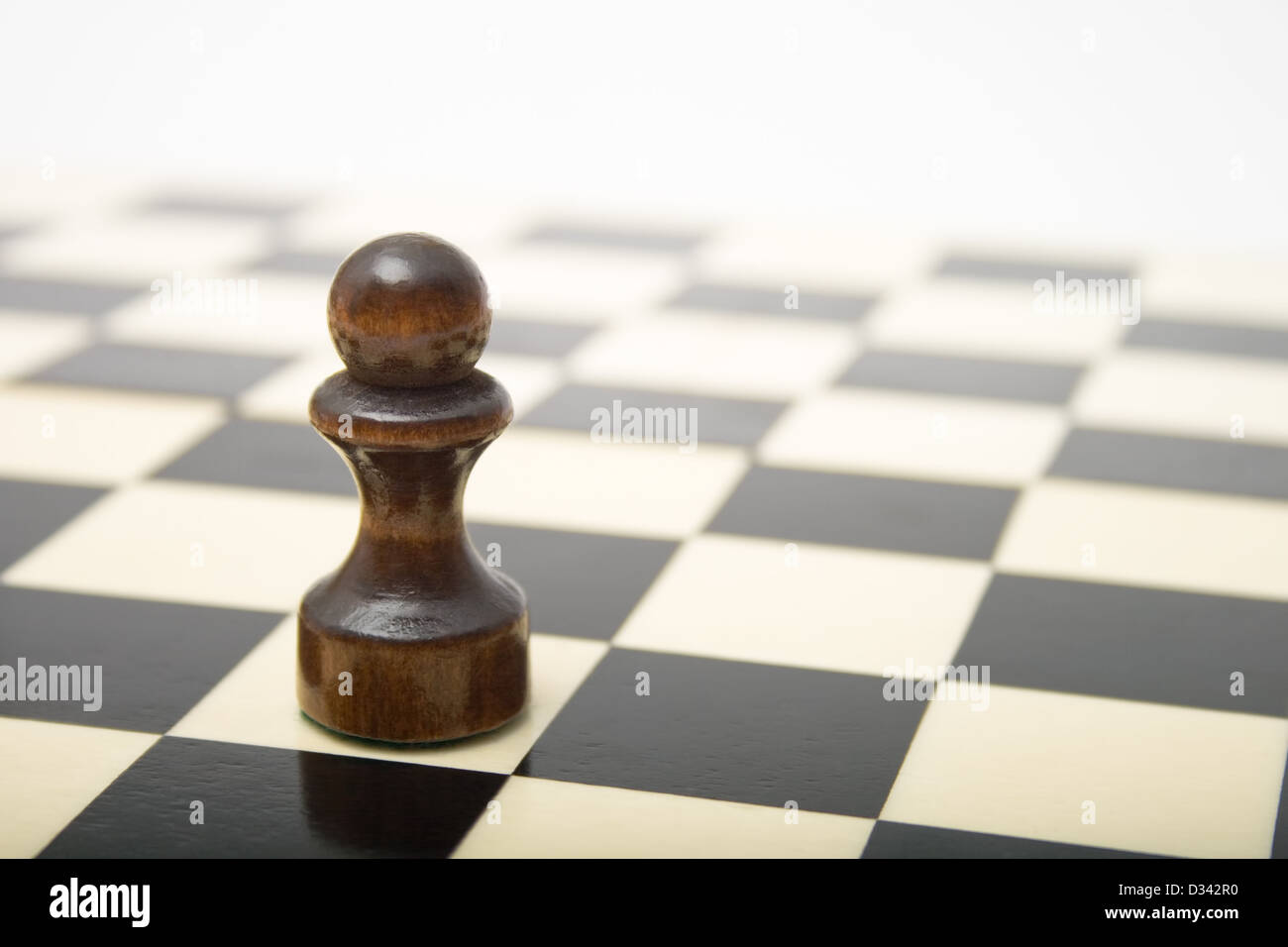 Black Pawn on a chess board - Stock Image