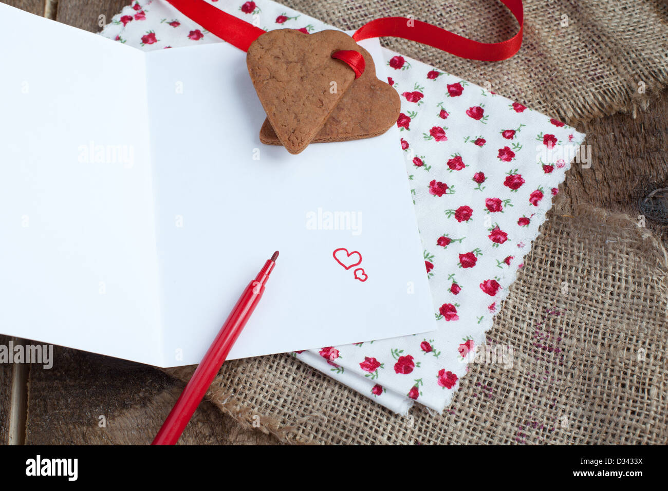 Saint Valentine's Love letter with heart shape cookies, hearts in rustic style - Stock Image
