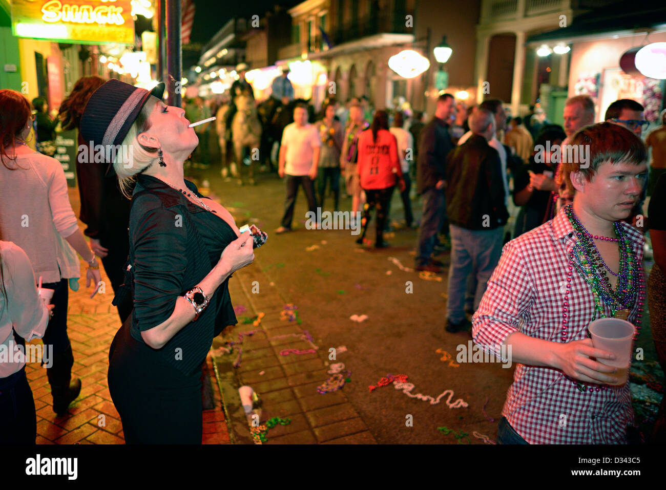 Woman Flashing Bourbon Street Mardi Gras New Orleans Stock