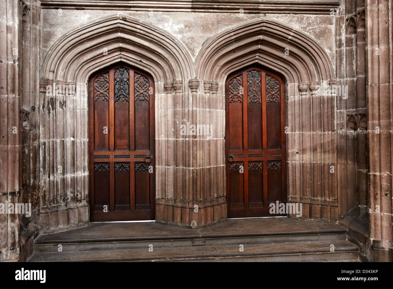 Pair of doors in Manchester Cathedral taken from inside the building - Stock Image