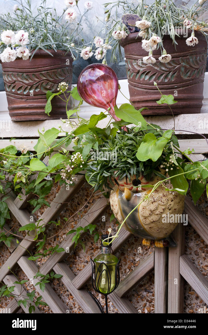 Garden decor and potted plants on the wall. Stock Photo