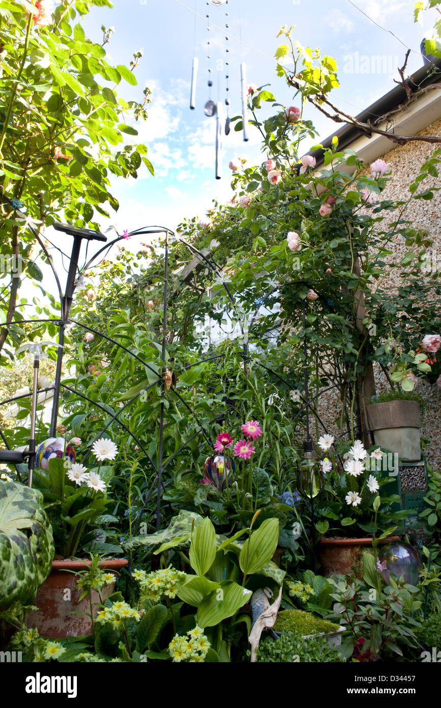 Part of the garden with plantings and decorations. Stock Photo