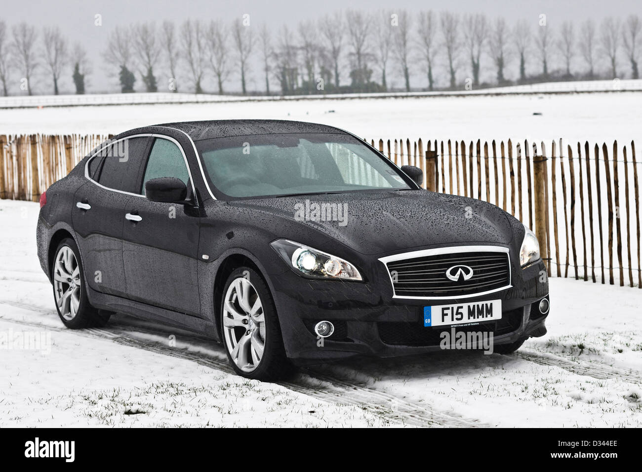 Infiniti M37 S in winter snow and bad weather, 20 12 10 - Stock Image