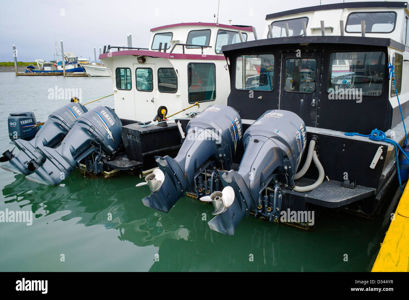 Charter and commercial fishing boats in the harbor, Homer, Alaska, USA. Large powerful outboard motors. - Stock Image