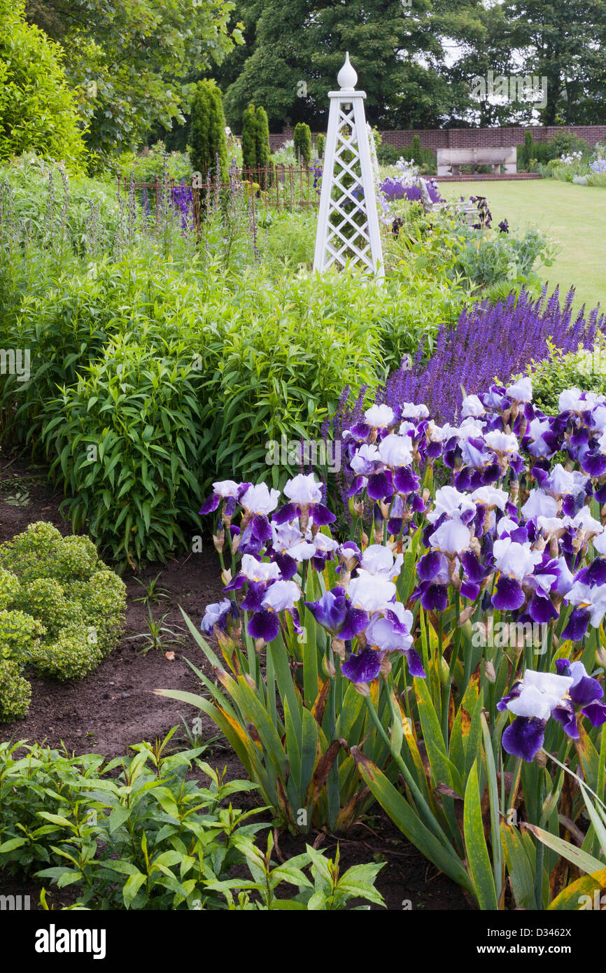 Spring borders in traditional country garden, Kent. Stock Photo