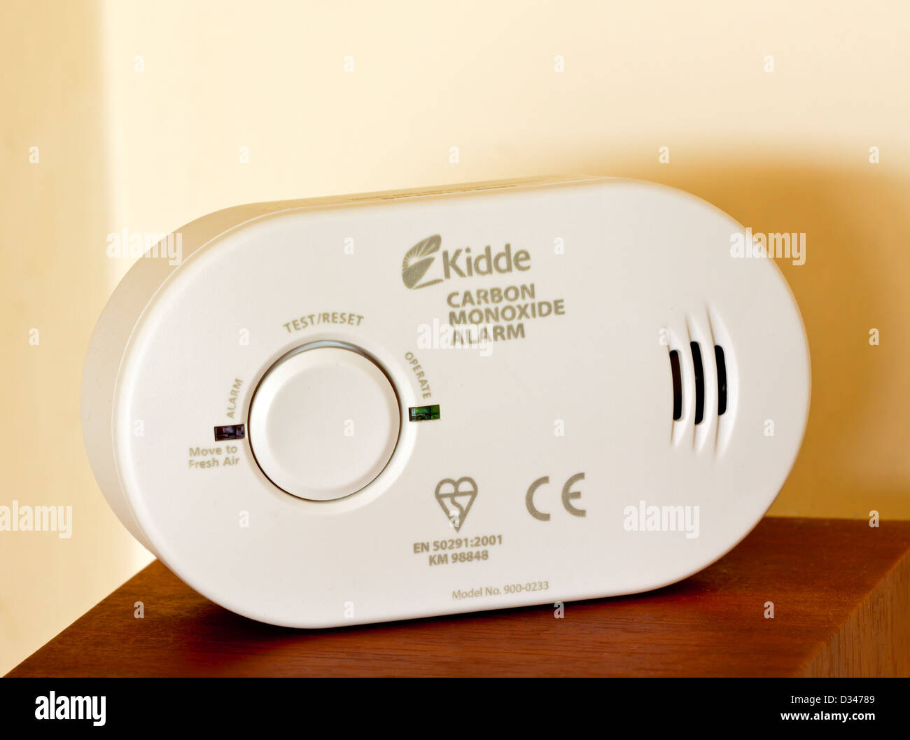 Domestic carbon monoxide alarm used in homes to detect the dangerous gas before causing poisoning or death - Stock Image
