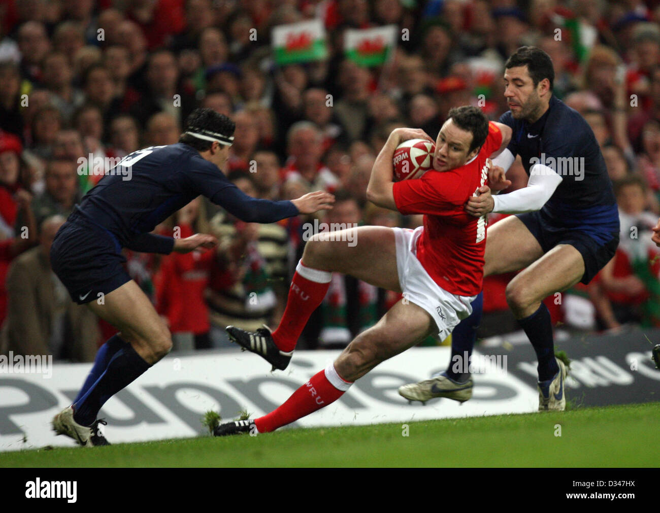 15.03.08. Wales v France. Wales' Mark Jones gets caught by Anthony Floch (left) and Julien Malzieu (rt) - Stock Image