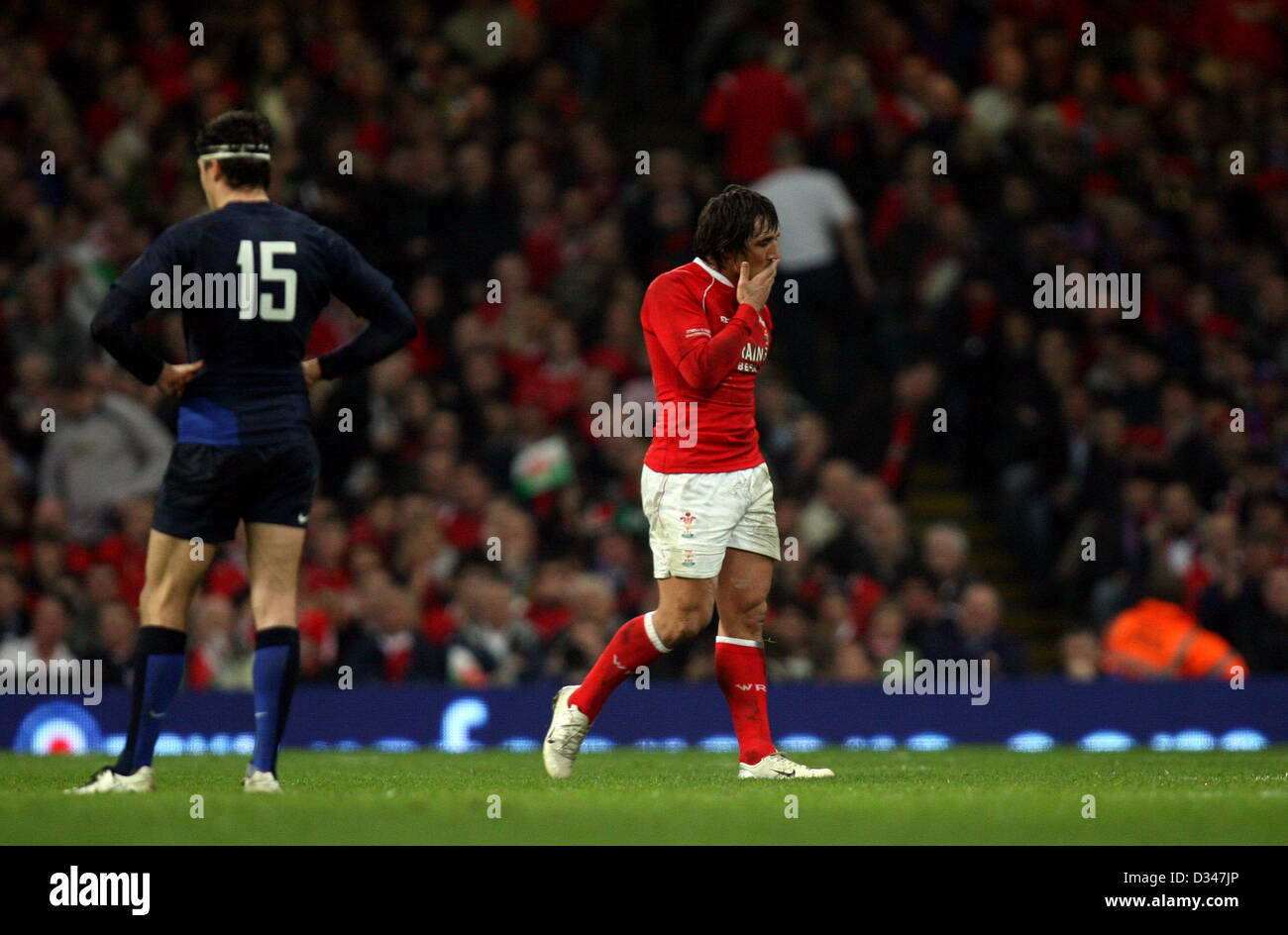 15.03.08. Wales v France. Wales' Gavin Henson heads for the bench after being yellow-carded. - Stock Image