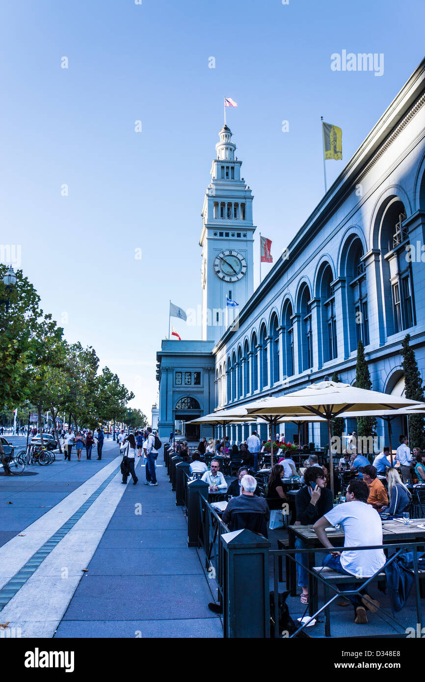 Diners enjoying the afternoon at a restaurant outside the Ferry Building in San Francisco California - Stock Image