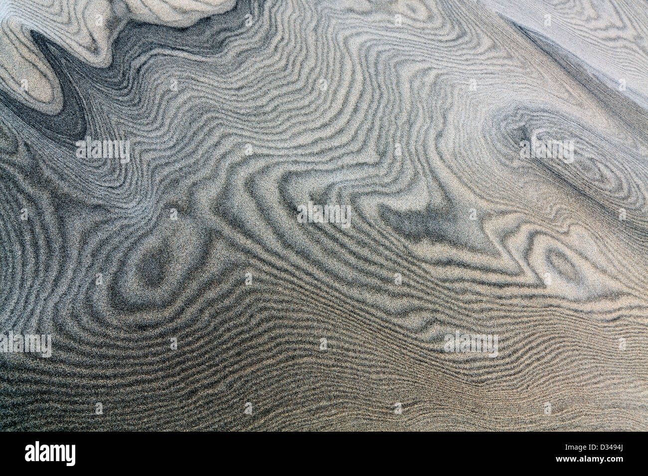 Wind sculpted sand dunes patterns at Mangawhai Heads - Stock Image