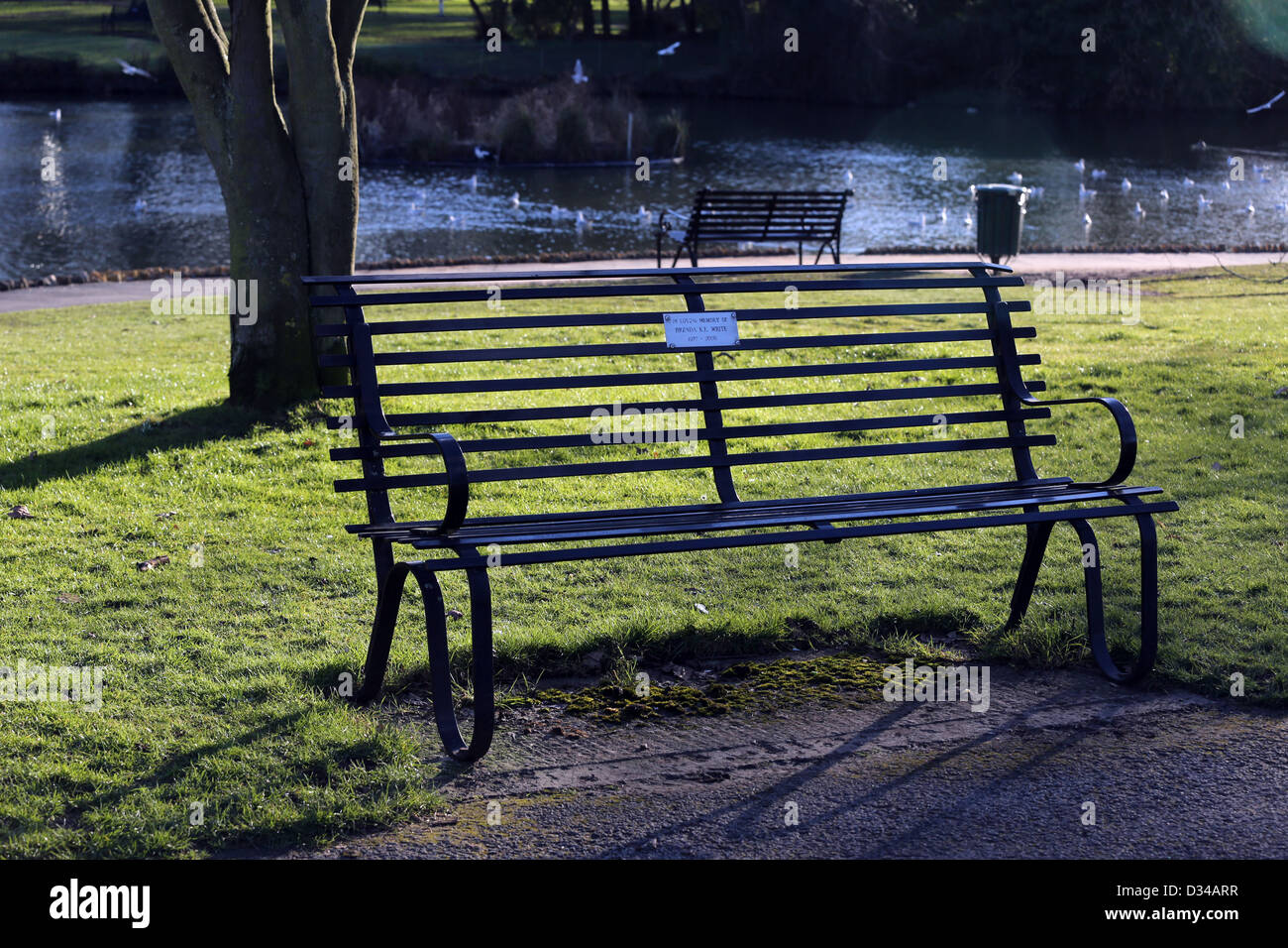 Memorial Benches By The Lake In The Pleasure Gardens Of The Pittville Pump  Room Cheltenham Gloucestershire England
