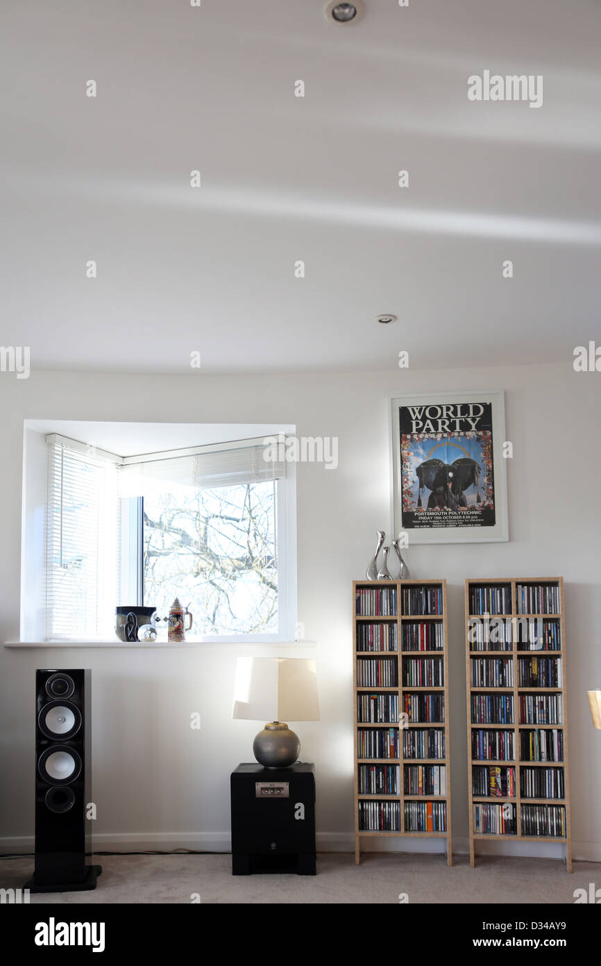 Open Plan Living Room With Speakers And CD's On Shelves Cheltenham Gloucestershire England - Stock Image