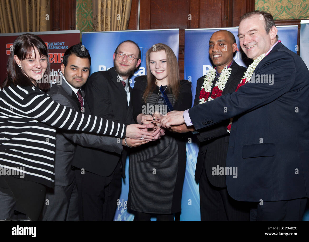 London, UK. 7th February 2013. Snappy Snap, Edgware, staff receiving their award for being The high street enterprise - Stock Image