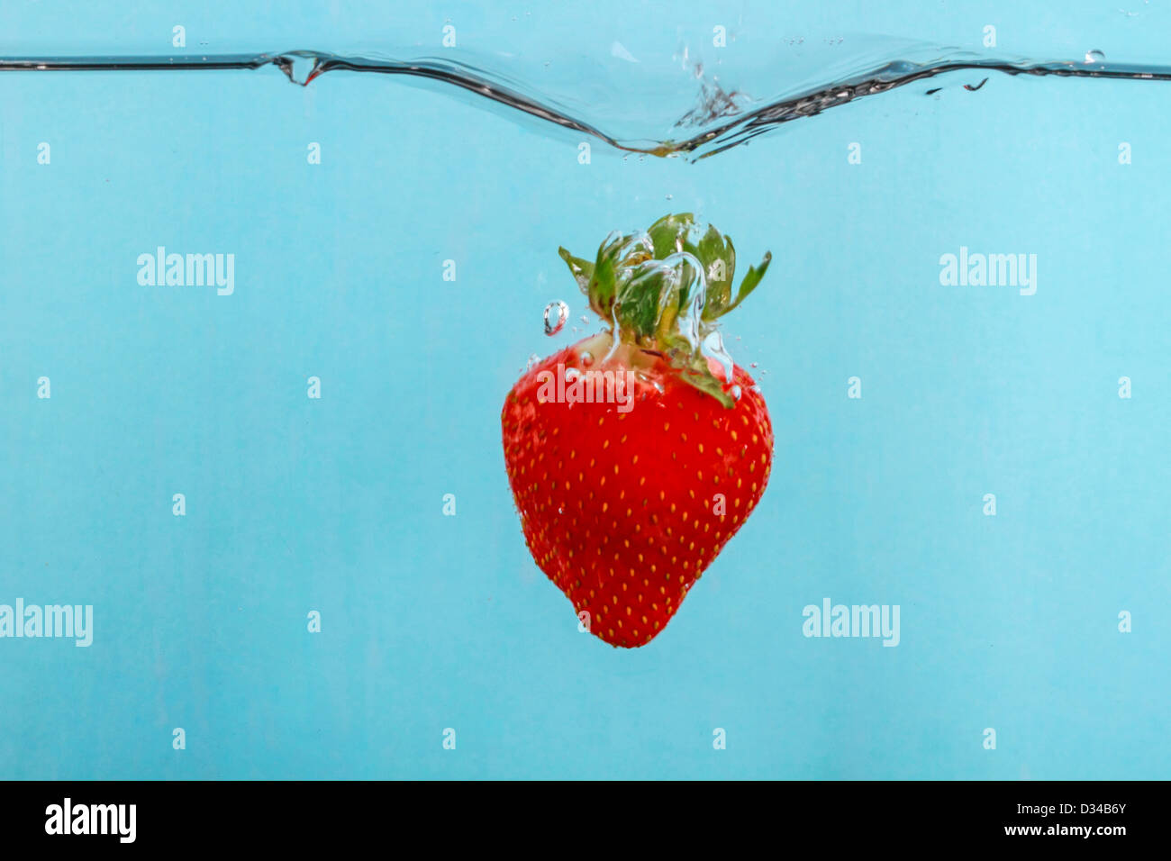 Strawberry Falling Into Water With Stop Motion Photography To Capture The Action