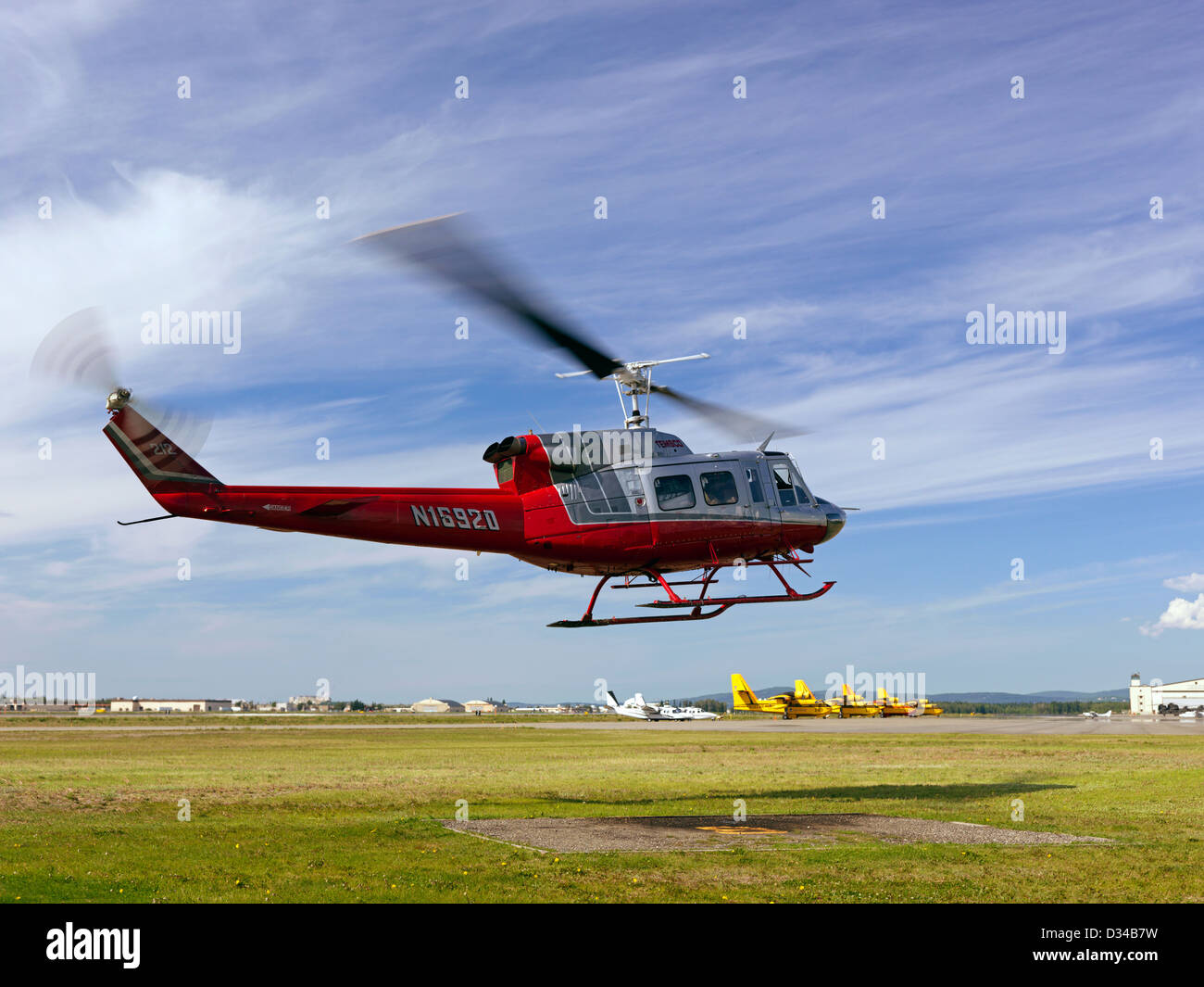Bell 212 helicopter taking off from Fort Wainwright in Fairbanks Alaska on a mission for US Forest Service fire - Stock Image