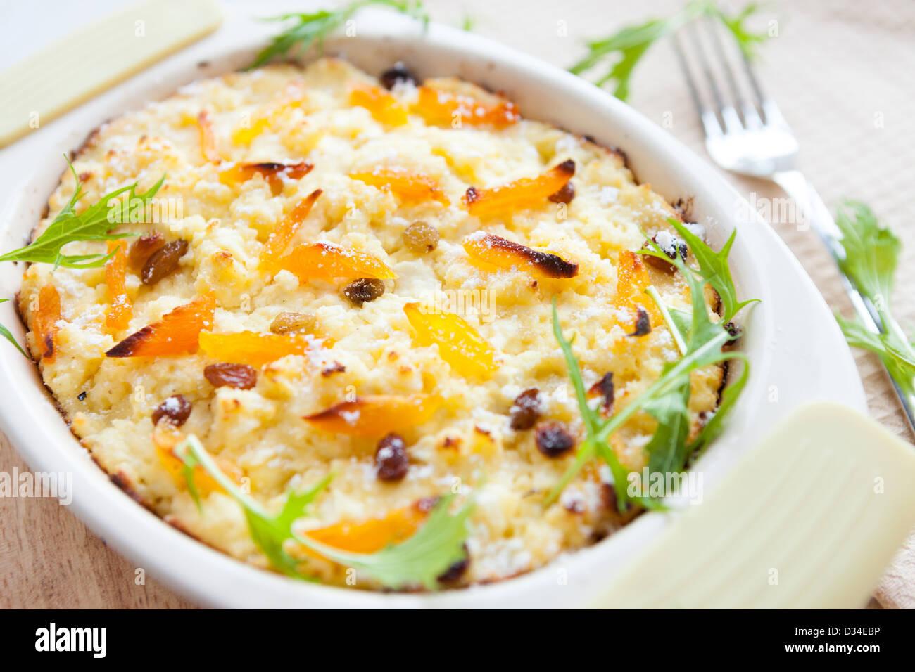 semolina casserole with dried apricots, closeup - Stock Image