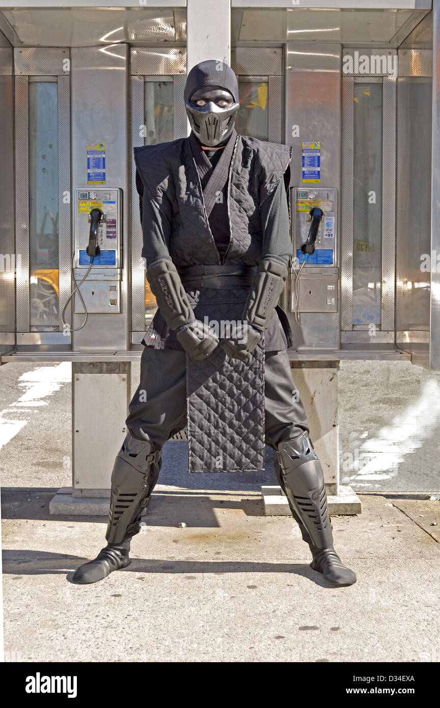Joel Rosado on the way to Comic Con NYC 2012 dressed as Noob Saibot a video character from the Mortal Kombat game - Stock Image
