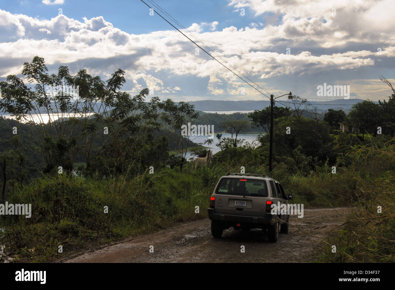 Jeep slowing down on a dirt road leading to Lake Arenal near the village Nuevo Arenal Costa Rica - Stock Image