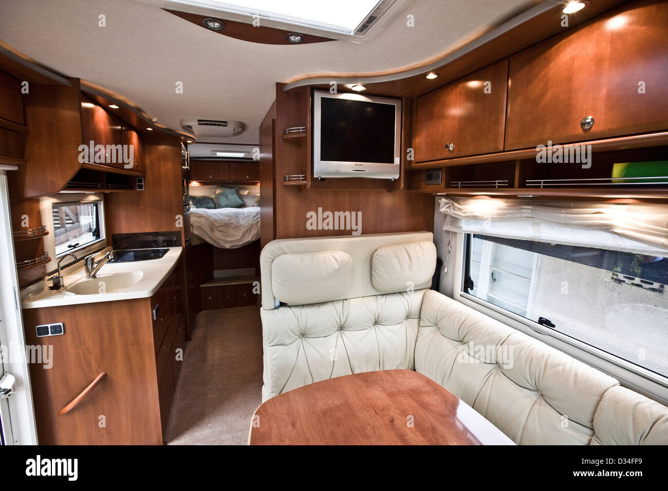 Seating area and sink in the Concorde luxury motorhome - Stock Image