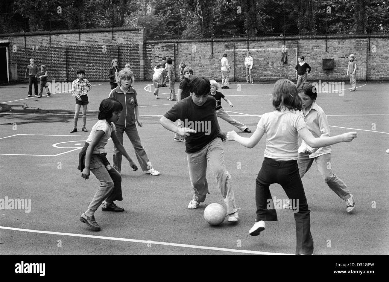 School Boys Playing Football In Junior School Playground