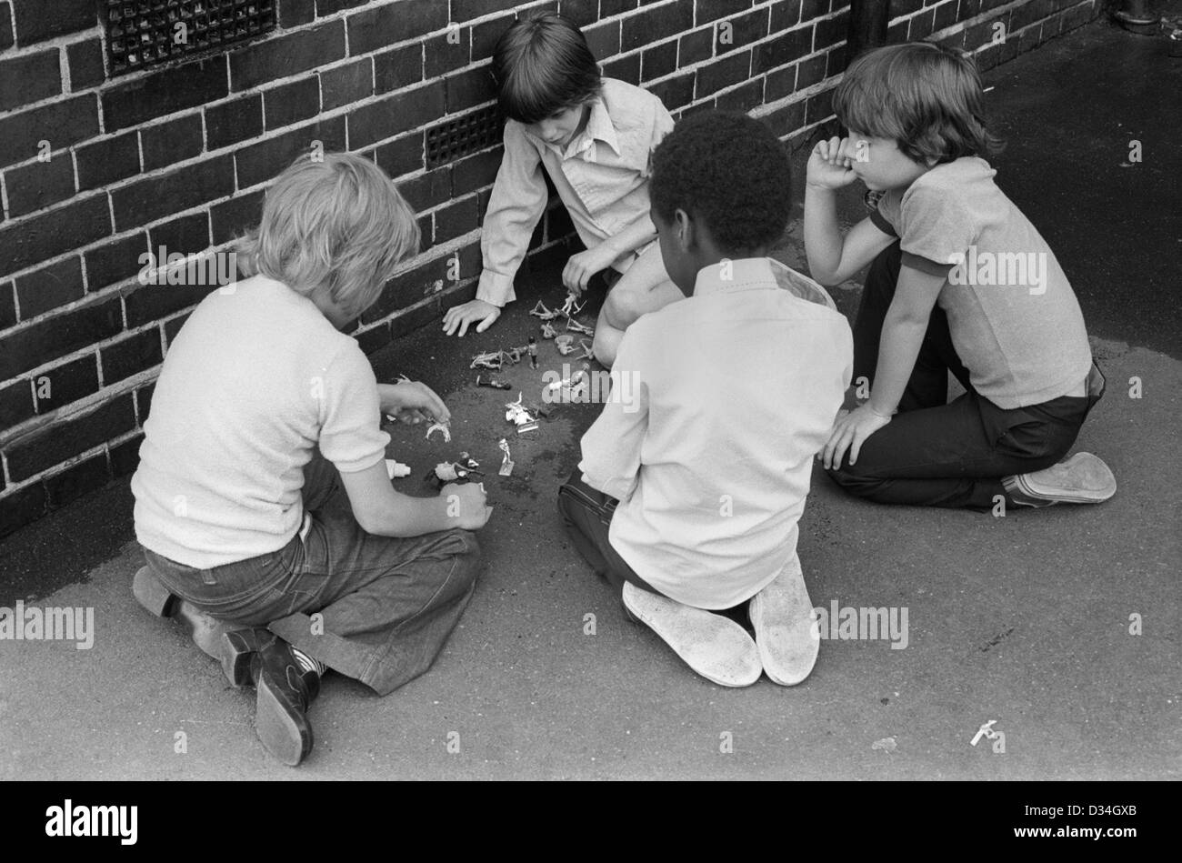 Playground games. South London junior school 1970s England . UK Boys playing with toy soldiers. HOMER SYKES - Stock Image