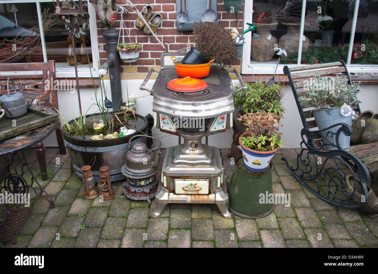 garden in holland with old tools and equipment - Stock Image