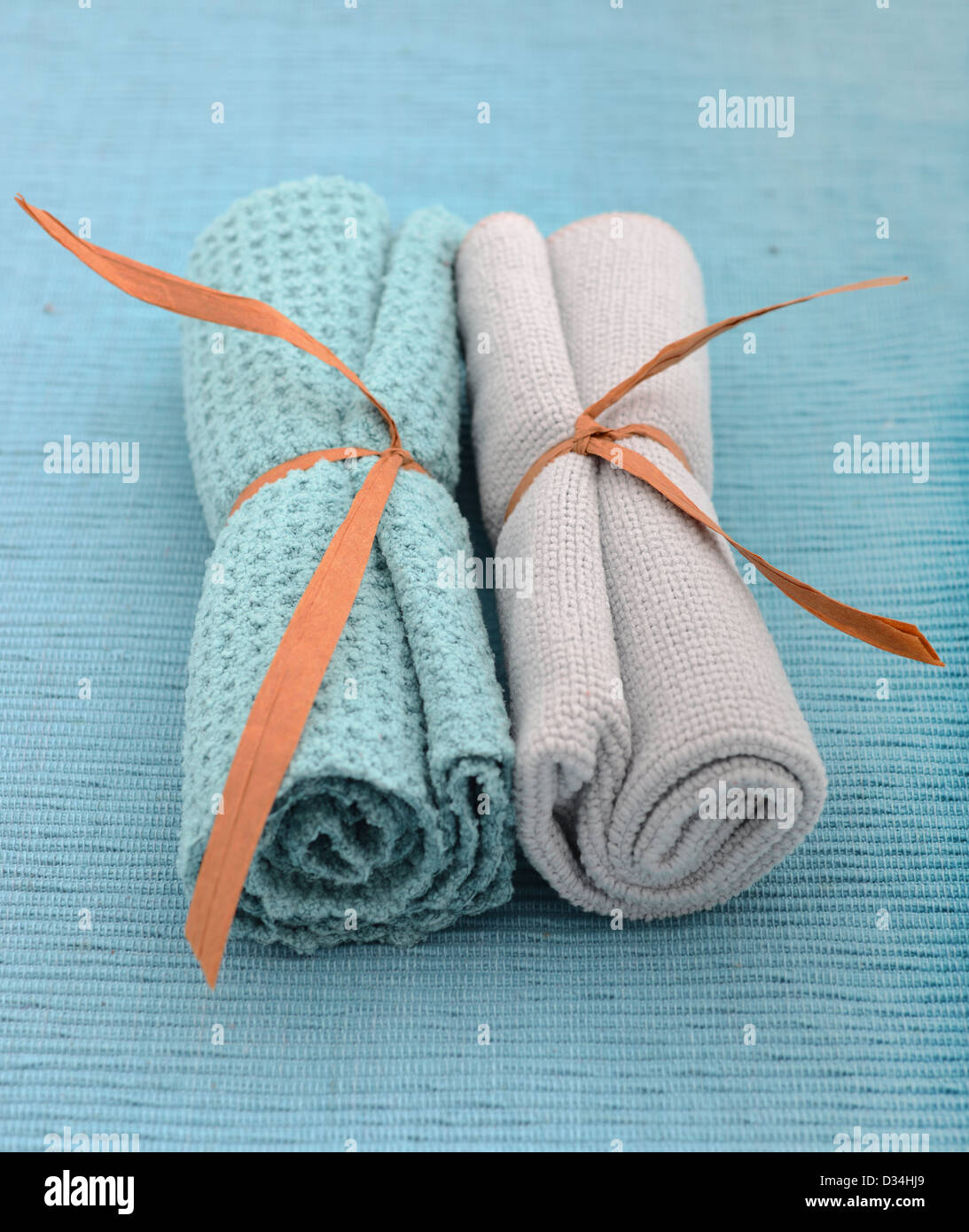 blue wash cloths rolled up for spa treatment Stock Photo