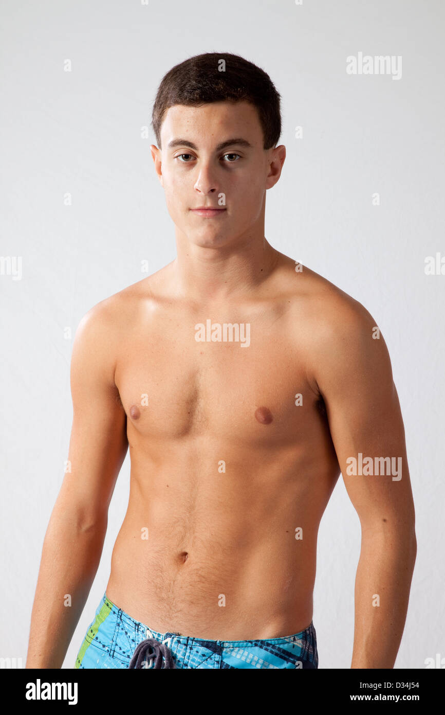 Young Man With No Shirt On Looking At The Camera With A Thoughtful
