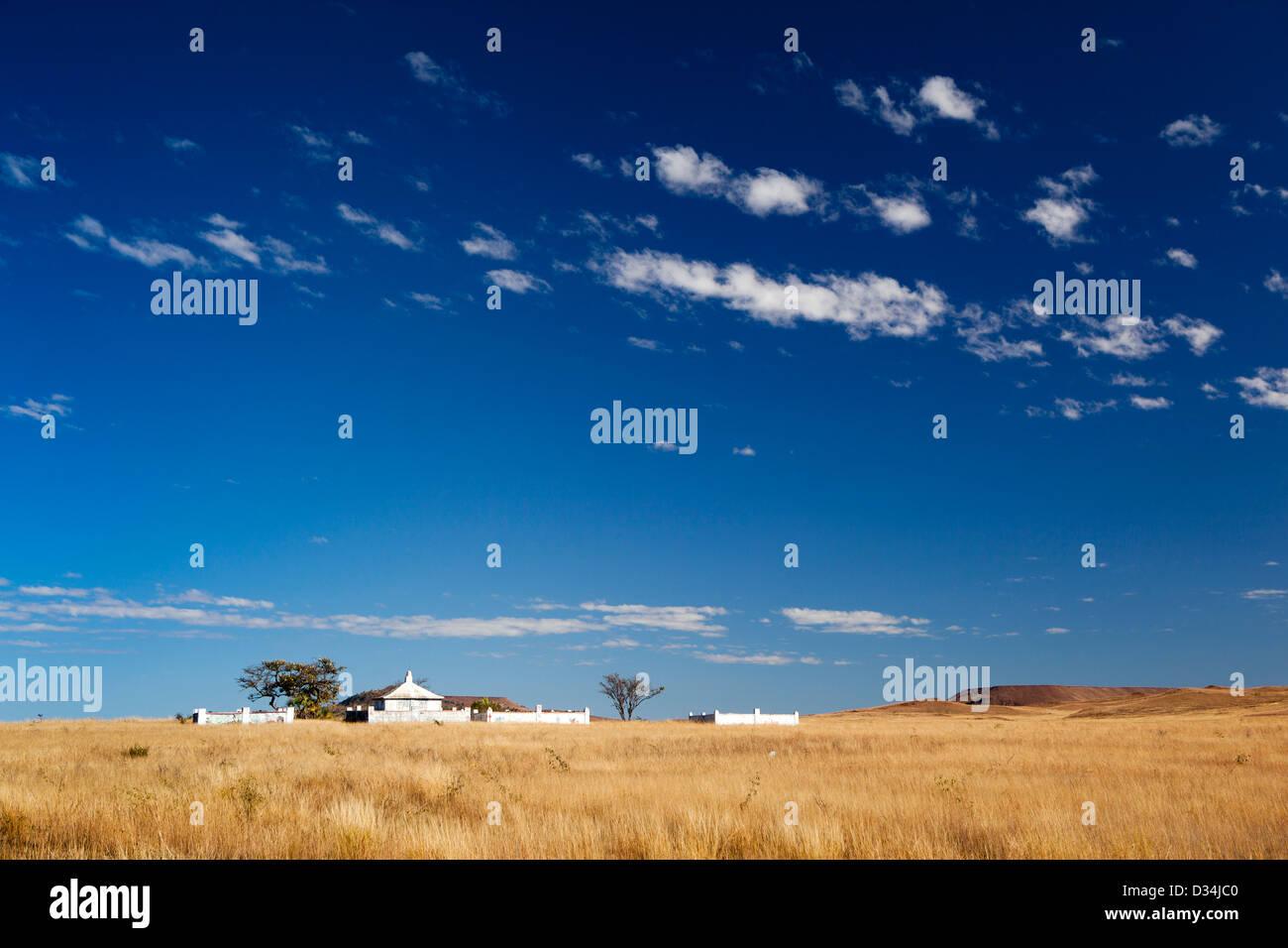 Madagascar, Ilakaka, large family tombs on horizon - Stock Image