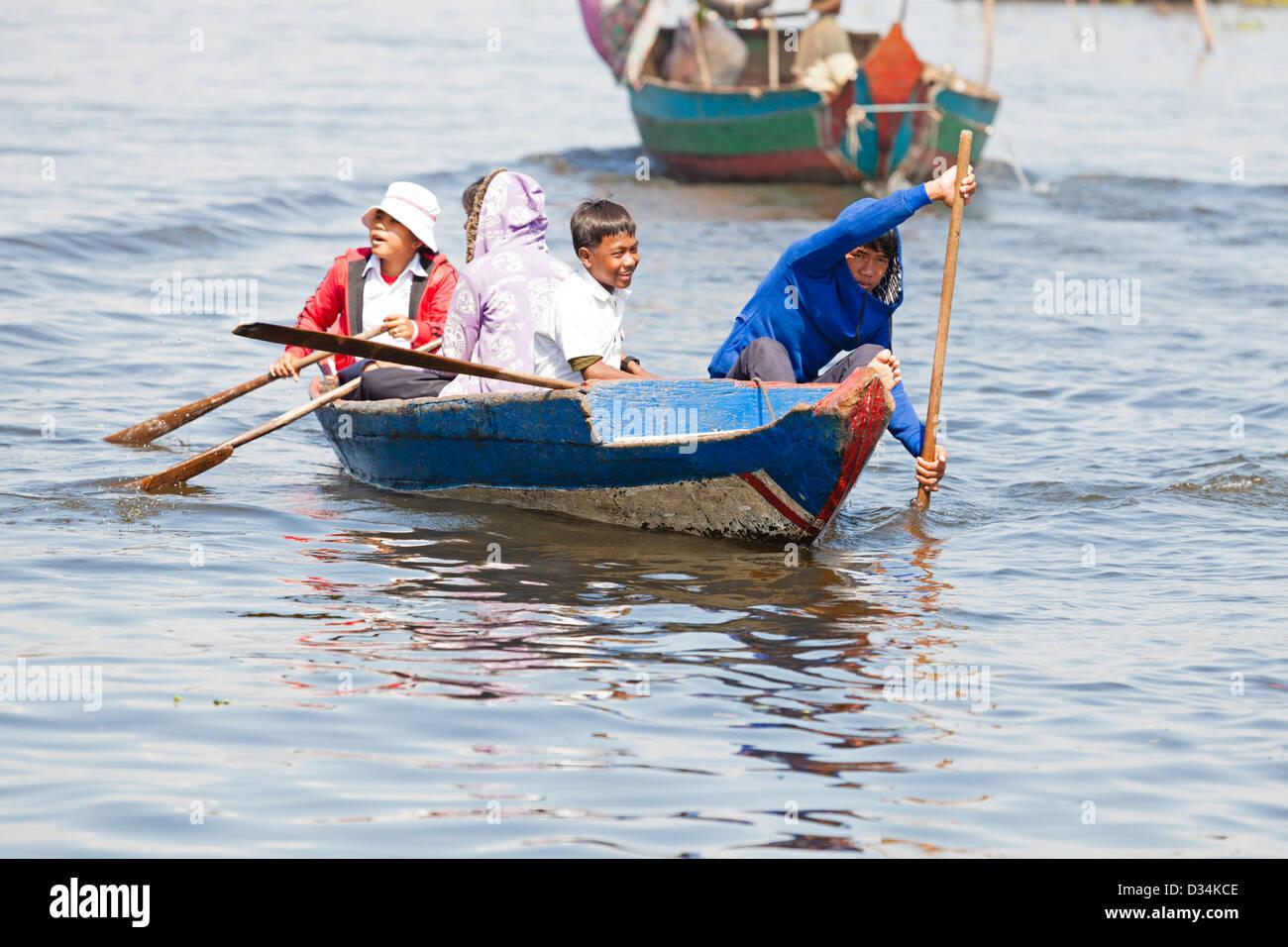 Schoolchildren of floating fishing village in Cambodia - Stock Image