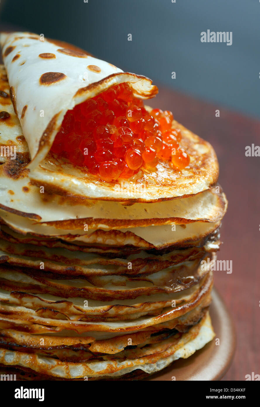 Traditional Russian pancakes with red caviar - Stock Image