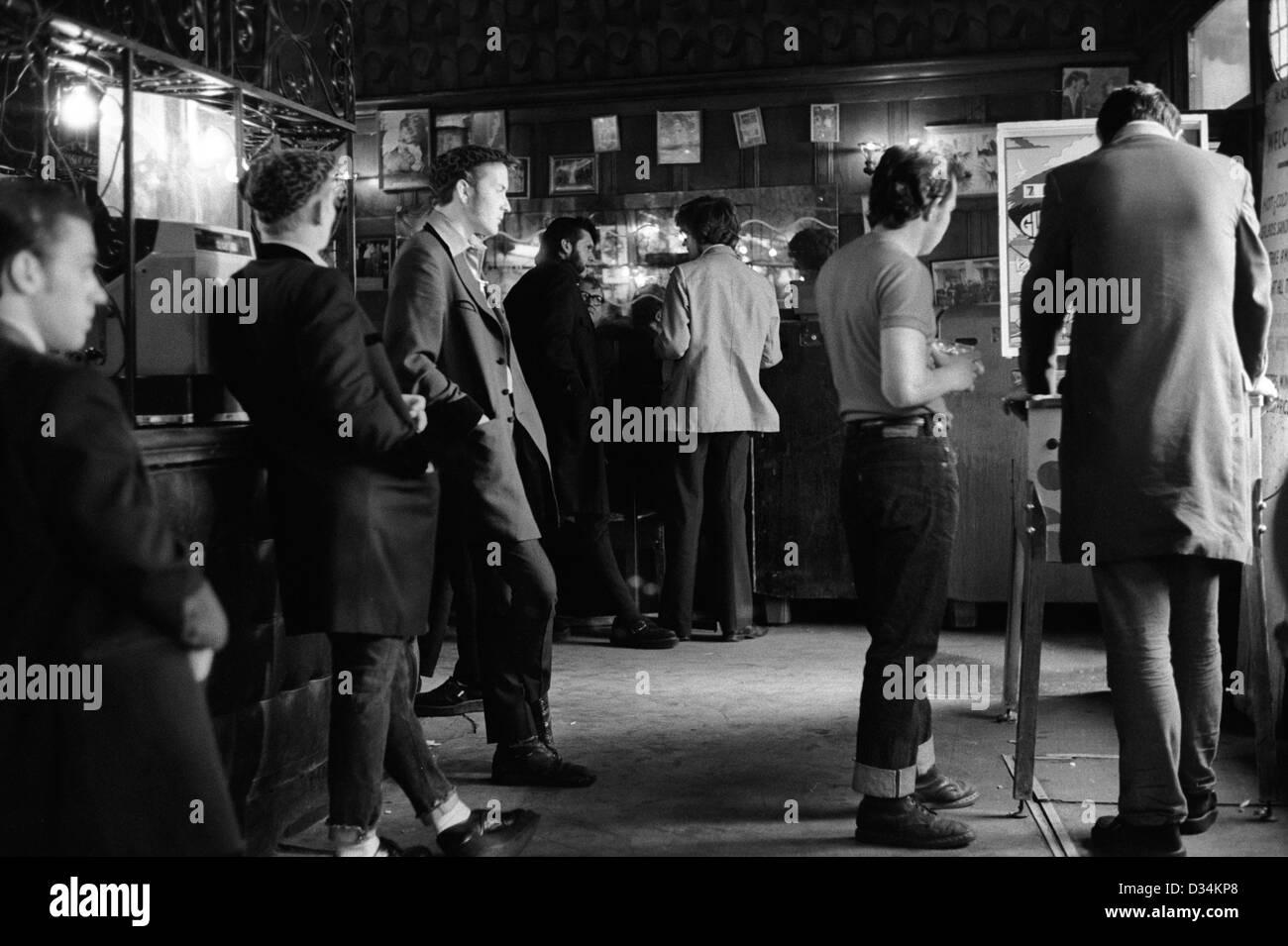 Teddy Boys wearing their distinctive drape jacket east London pub. Whitechapel London 1970s Britain. 70s UK HOMER - Stock Image