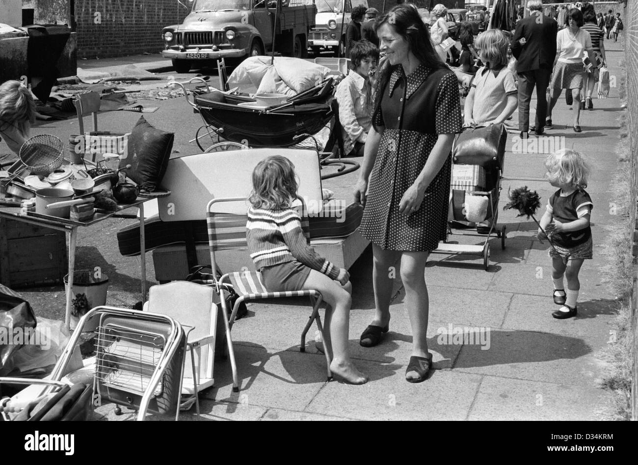 Portobello Road Saturday market 1970s London.  This is at the north end which was not prosperous. Families used - Stock Image
