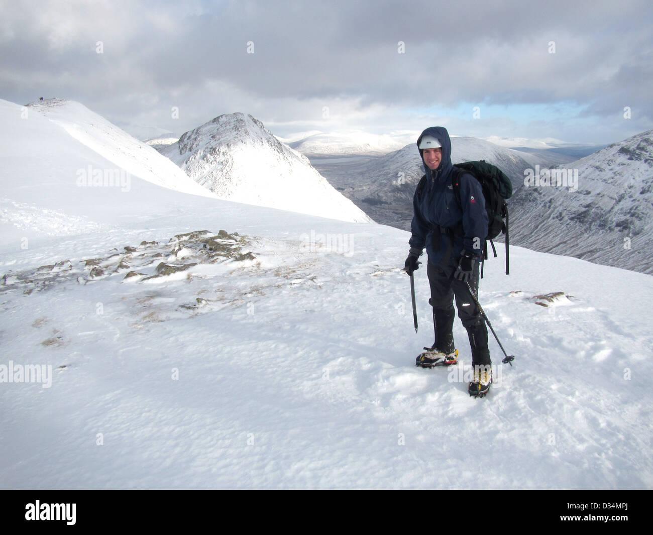 A mountaineer on the Scottish mountain Buachaille Etive Beag  in Glencoe  in Scottish highlands, Scotland UK Stock Photo