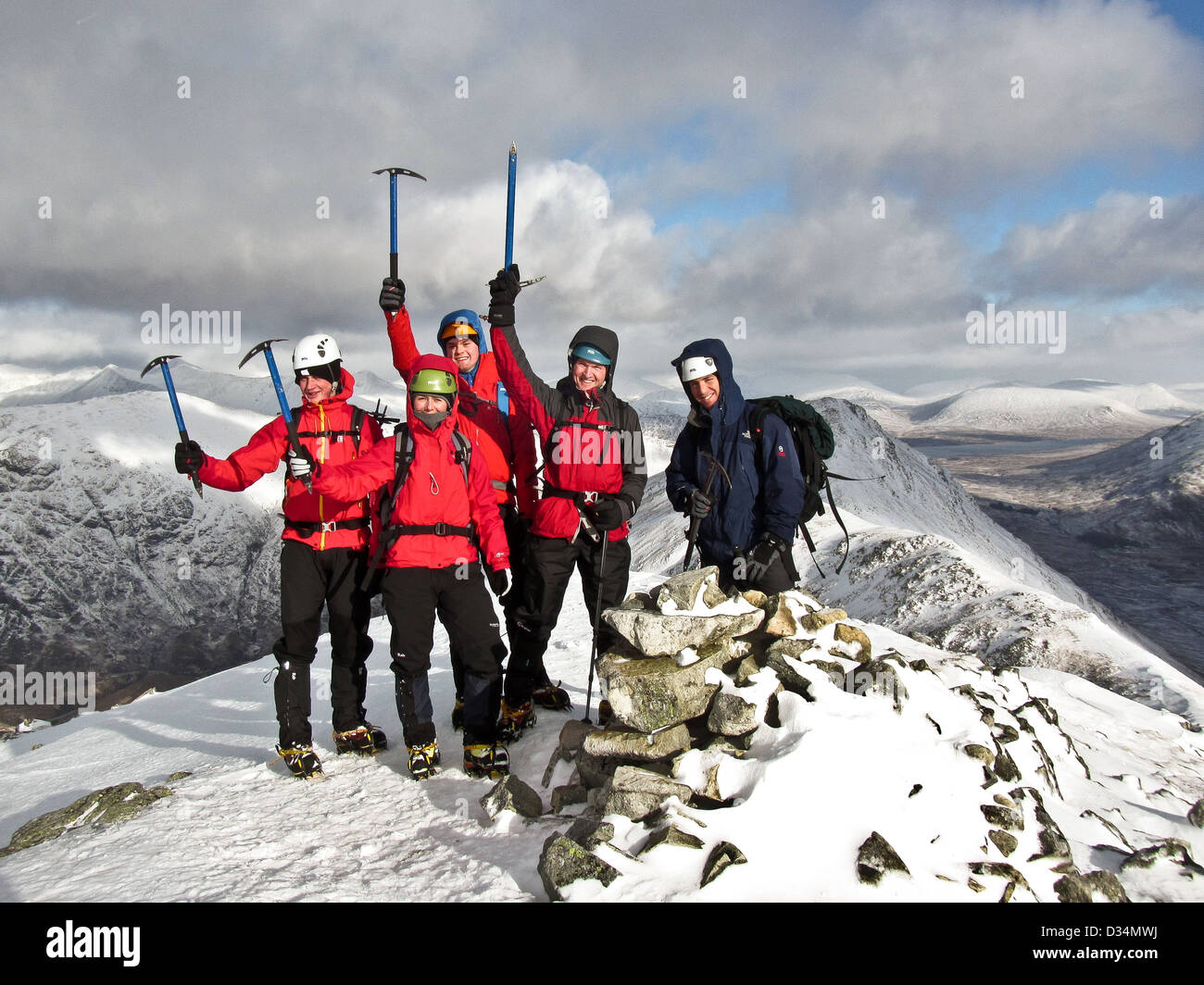 A group of winter mountaineers on the summit of Buachaille Etive Beag in Glencoe in Scottish highlands Scotland Stock Photo